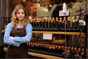 Image of girl standing in front of small business