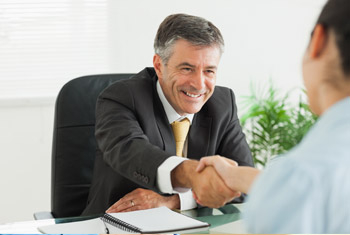 Image of a man shaking hands with someone