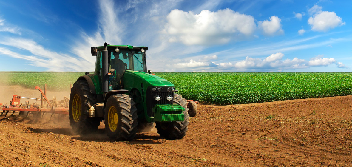 Image of a tractor being driven through a field